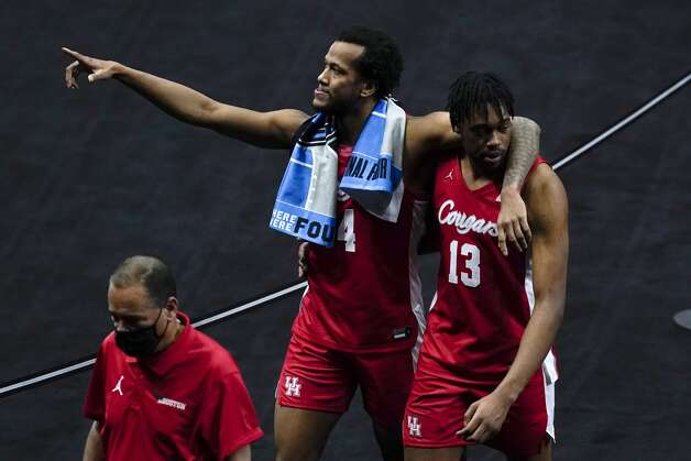 Houston forward Justin Gorham, left, walks off the court with teammate forward J'Wan Roberts (13) at the end of a men's Final Four NCAA college basketball tournament semifinal game against Baylor, Saturday, April 3, 2021, at Lucas Oil Stadium in Indianapolis. Baylor won 78-59. (AP Photo/Michael Conroy) Photo: Michael Conroy/Associated Press / Copyright 2021 The Associated Press. All rights reserved.