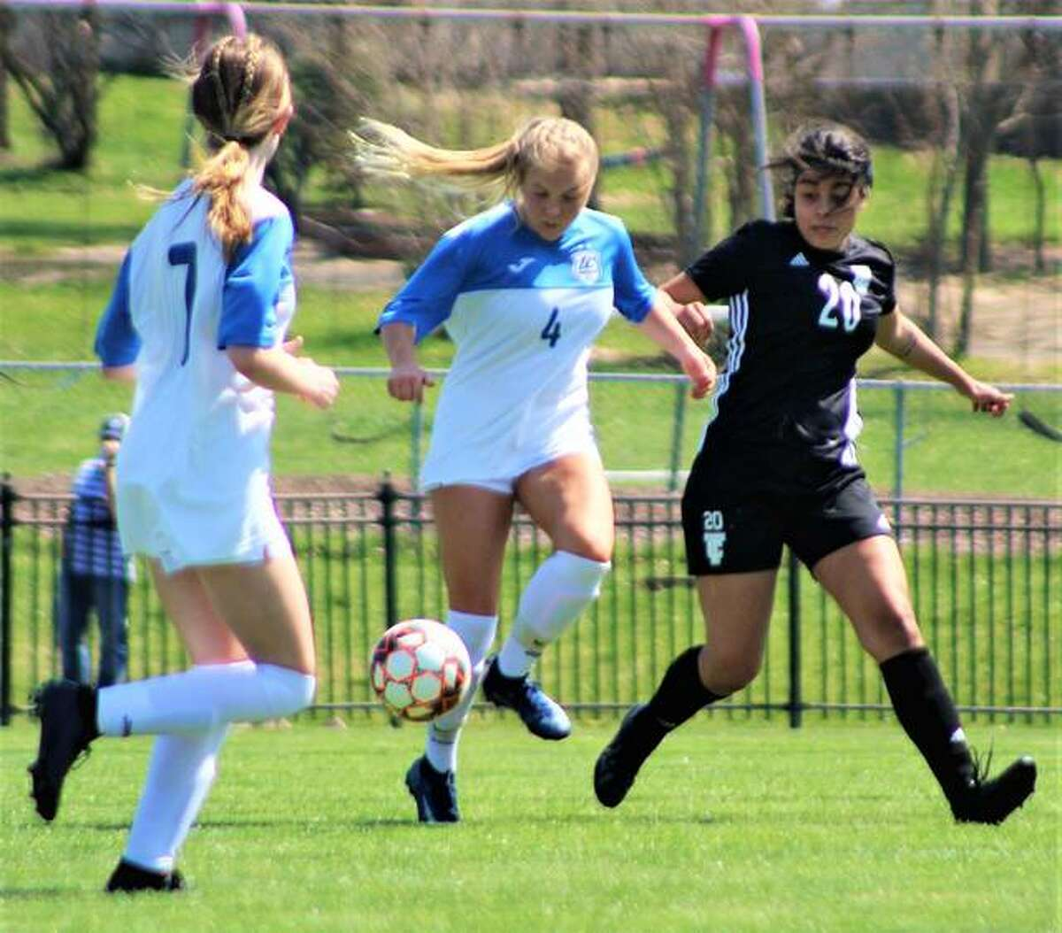 Skylar Hollingshead of LCCC (4) settles the ball Saturday against Triton at Tim Rooney Stadium. At left is LCCC's Chelsea Riden.