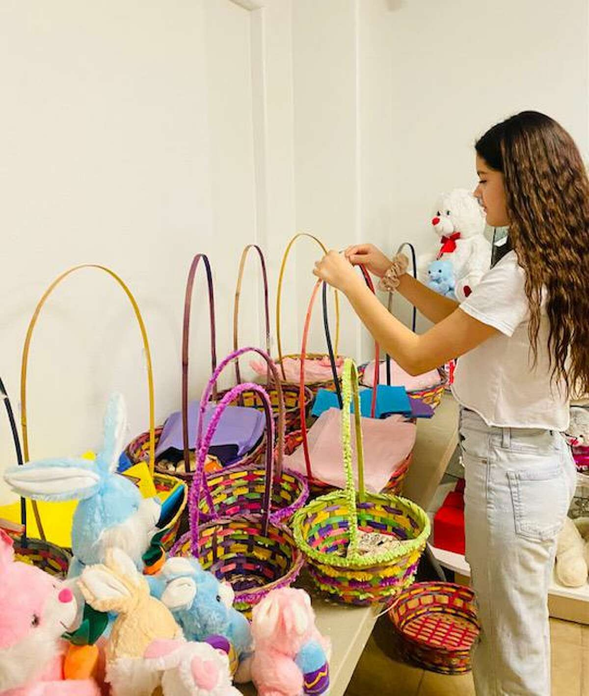 Miss Jr. Laredo Alheyda J. Guerra, 13, prepares Easter baskets for donation to kids around the city. She helped lead the donation of 116 baskets for this holiday.