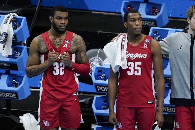 Houston forward Reggie Chaney (32) and forward Fabian White Jr. (35) watch the end of a men's Final Four NCAA college basketball tournament semifinal game against Baylor, Saturday, April 3, 2021, at Lucas Oil Stadium in Indianapolis. Baylor won 78-59. (AP Photo/Darron Cummings) Photo: Darron Cummings/Associated Press / Copyright 2021 The Associated Press. All rights reserved.