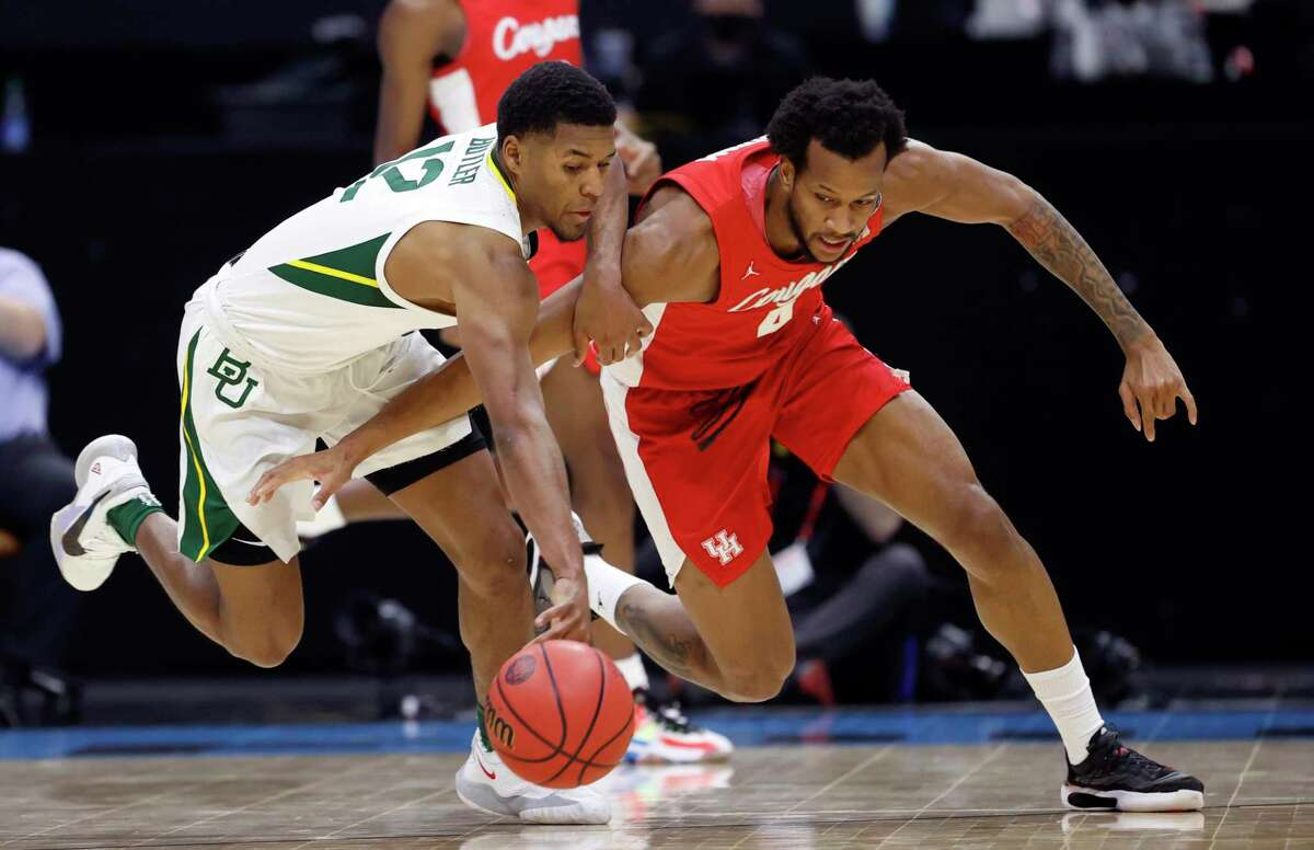 Baylor's Jared Butler, left, and Houston's Justin Gorham battle for a loose ball in the first half Saturday.