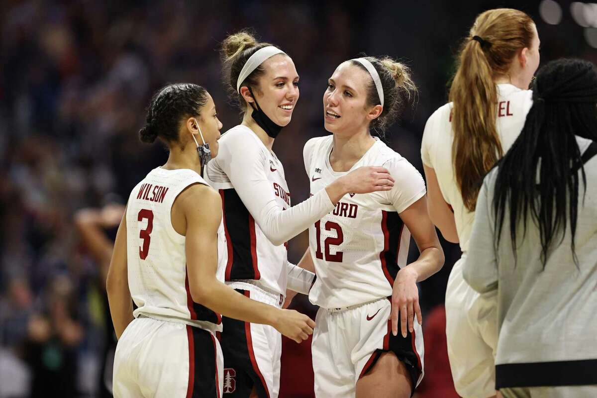Stanford's Lexie Hull (12) and Lacie Hull (24) celebrate after reaching title game.