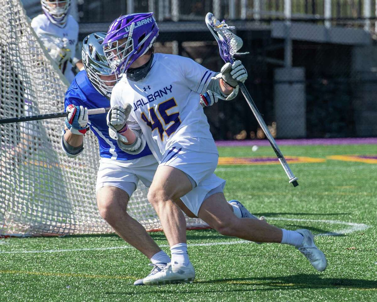 UAlbany sophomore Graydon Hogg looks for room in front of UMass Lowell freshman Tanner Soudan during a game at John Fallon Field on the UAlbany campus in Albany, NY, on Saturday, April 3, 2021. (Jim Franco/Special to the Times Union)