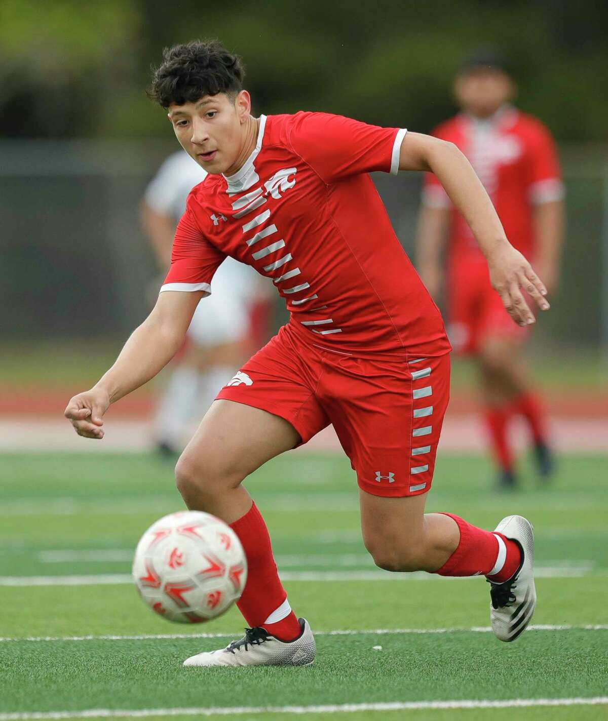 Splendora's Martin Barajas (7) looks to control the ball during the first period of a Region III-4A quarterfinal high school soccer match at Wildcat Stadium, Saturday, April 3, 2021, in Splendora.