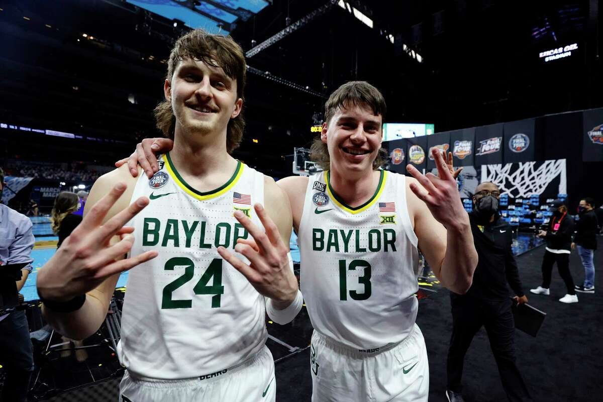 Magnolia High School alum Jackson Moffatt (13) and and Baylor teammate Matthew Mayer (24) celebrate defeating the Houston Cougars 78-59 in the 2021 NCAA Final Four semifinal to advance to the National Championship game at Lucas Oil Stadium on April 03, 2021 in Indianapolis, Indiana.