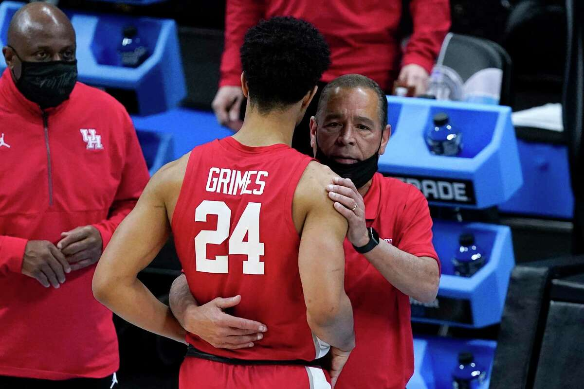 Houston guard and College Park High School alum Quentin Grimes (24) gets a hug from head coach Kelvin Sampson at the end of a men's Final Four NCAA college basketball tournament semifinal game against Baylor, Saturday, April 3, 2021, at Lucas Oil Stadium in Indianapolis. (AP Photo/Darron Cummings)