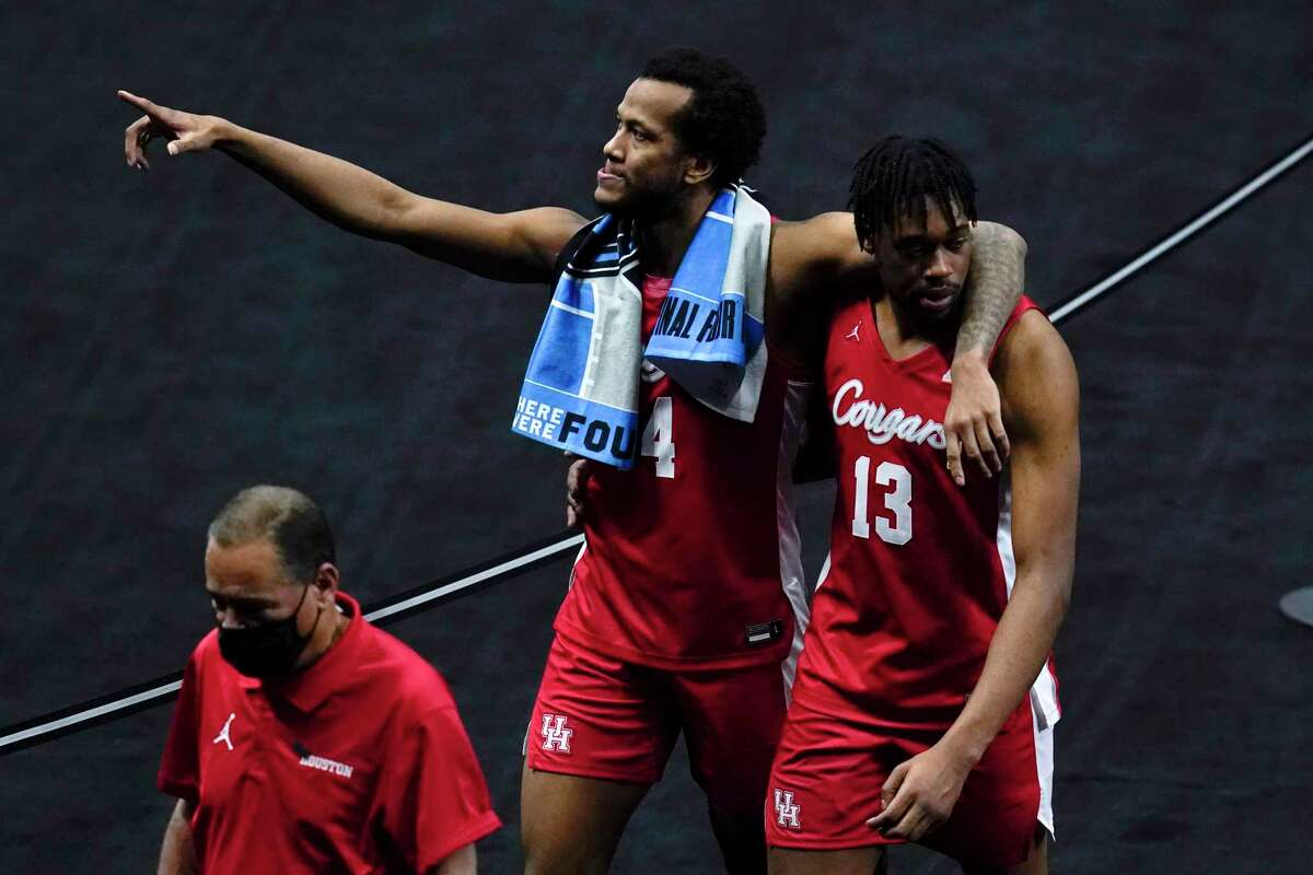 The Cougars and forward Justin Gorham, walking off the court with J'Wan Roberts (13) after Saturday's loss to Baylor, can point to many highs for the season.