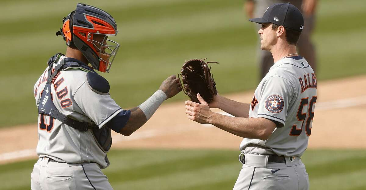 Brooks Raley #58 and Martin Maldonado #15 of the Houston Astros congratulate one another after they beat the Oakland Athletics at RingCentral Coliseum on April 03, 2021 in Oakland, California. (Photo by Ezra Shaw/Getty Images)
