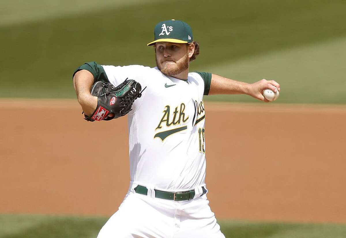 OAKLAND, CALIFORNIA - APRIL 03: Cole Irvin #19 of the Oakland Athletics pitches against the Houston Astros in the first inning at RingCentral Coliseum on April 03, 2021 in Oakland, California. (Photo by Ezra Shaw/Getty Images)