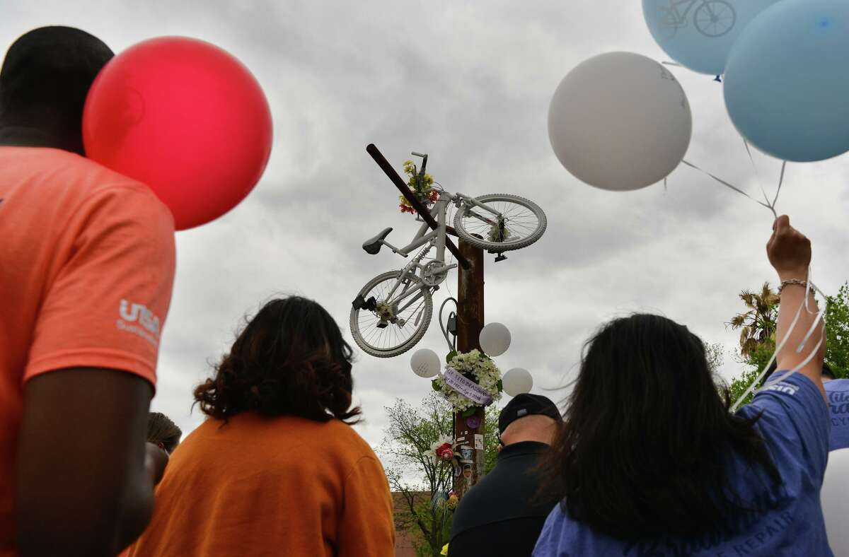 """Friends and family of the late Tito Bradshaw release balloons Saturday at a memorial service on E. Houston Street near N. New Braunfels by the white """"ghost bike"""" that marks where he was killed in April 2019 by an alleged drunk driver."""