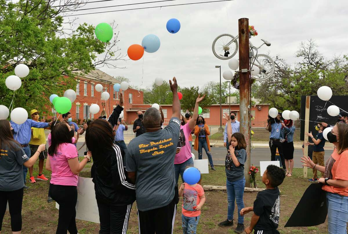 Friends and family release balloons Saturday to honor Tito Bradshaw who was riding his bicycle when he was struck by an alleged drunk driver in April 2019. The Saturday event took place at Bradshaw's Ghost Bike Memorial on East Houston Street.