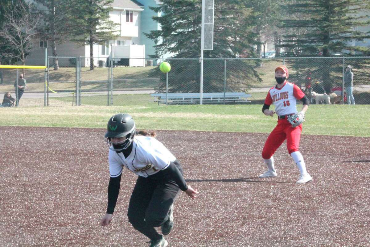Ferris second baseman Kacey Bouche (16) watches her throw to first base to double up the Wayne State baserunner during the second game of Saturday's GLIAC twinbill. (Pioneer photo/John Raffel)