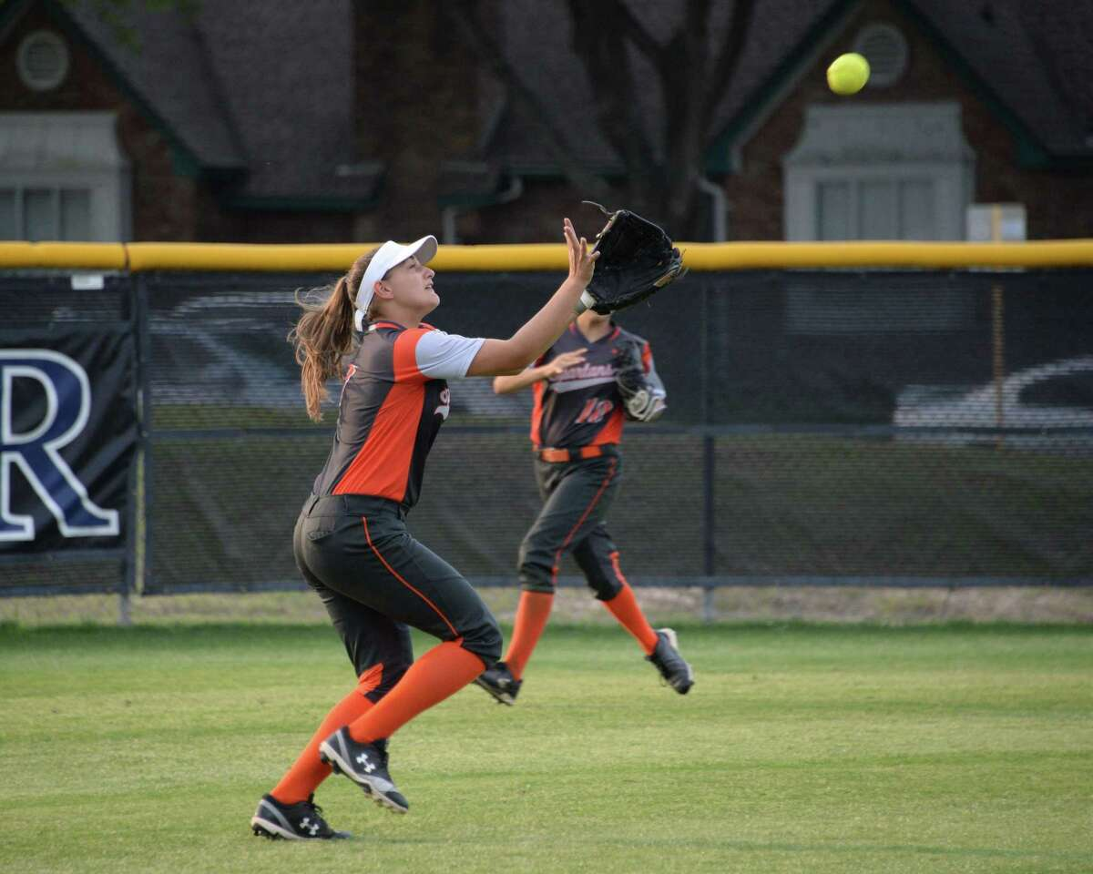 Meagan Kelly (17) of Seven Lakes chases a fly ball during the second inning of a high school softball game between the Taylor Mustangs and the Seven Lakes Spartans on Friday, April 12, 2019 at Taylor High School, Katy, TX.