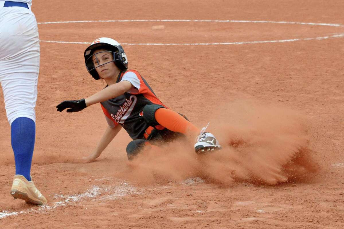Makinzie Stutts (3) of Seven Lakes slides into third base during the third inning of a high school softball game between the Taylor Mustangs and the Seven Lakes Spartans on Friday, April 12, 2019 at Taylor High School, Katy, TX.