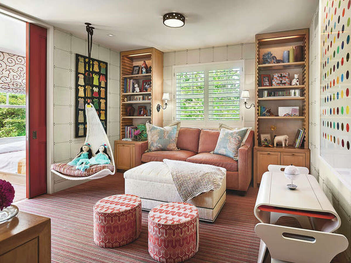 """Interiors firm Marguerite Rodgers added a playful, cheery red pocket door to a recent kids' room project. """"The pop of color really ties the space together,"""" says designer Kaitlyn Murphy. """"You can easily refresh existing millwork by adding a wall covering, textile or a fun paint color."""