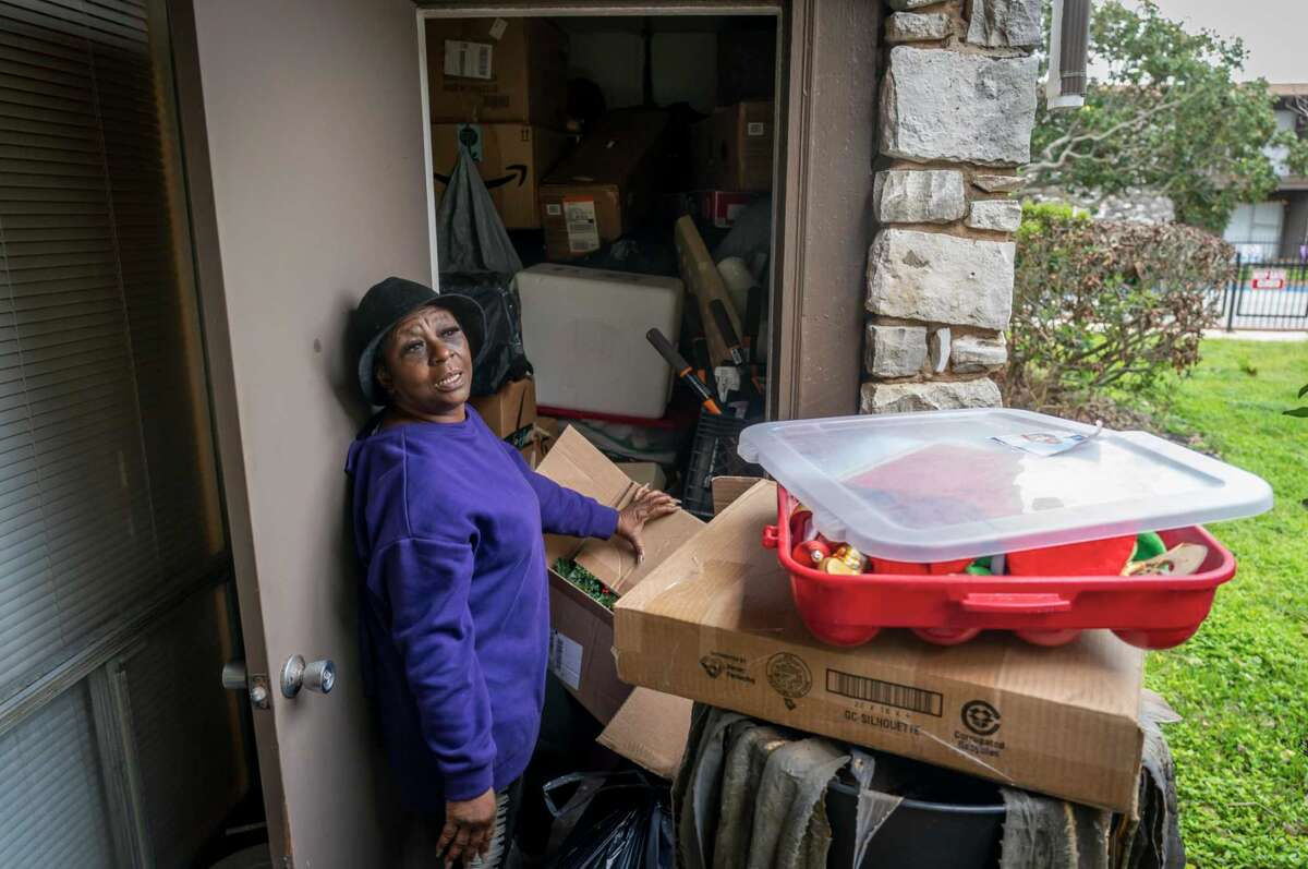 Patricia Moon pulls some of her belongings out of a storage closet outside her apartment at the Fort Crockett apartments, Sunday, March 28, 2021, in Galveston. The complex, owned by Landry's Inc., is being shut down due to the February freeze which apparently devastated the piping infrastructure beyond repair. It is one of the only affordable apartment complexes on Seawall Boulevard. Moon has lived in the apartment since 2008 when she move there after Hurricane Ike.