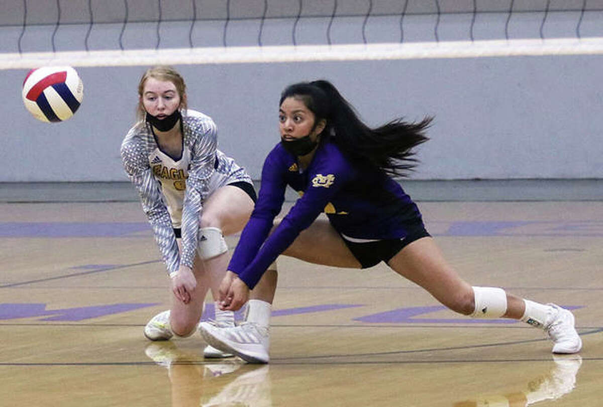 CM libero Ella Middleton (right) and DS Reese Ferguson get down for a Roxana serve in the first set of a nonconference girls volleyball match Saturday at Bethalto. The Shells rallied from a 24-21 deficit to win the first game 28-26, but the host Eagles rallied to win the final two games 25-18, 25-17 to halt a four-match losing streak to Roxana.