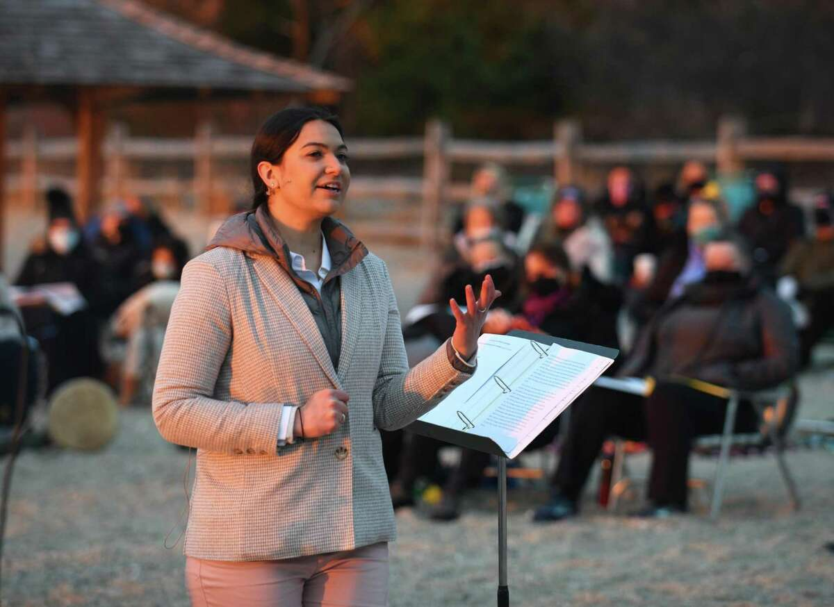 Associate Pastor the Rev. Cydney Van Dyke leads the Easter Sunrise Beach Service at Greenwich Point Park in Greenwich, Conn. Sunday, April 4, 2021. Presented by First Congregational Church of Greenwich, congregants gathered on the beach to watch the sunrise on a clear Easter morning while worshipping with music from the First Church youth choir and a sermon led by Associate Pastor the Rev. Cydney Van Dyke.