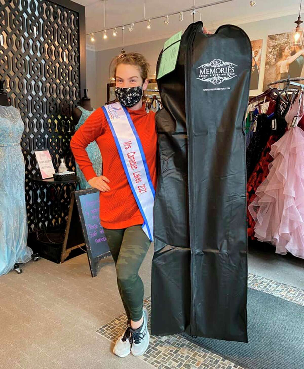 Jackie Blankenship, who will represent Mrs. Canadian Lakes in this year's Mrs. Michigan for America Pageant, is pictured at her favorite dress shop, Memories Bridal & Evening Wear, in Kalamazoo picking up her evening gown for the pageant. (Courtesy photo)