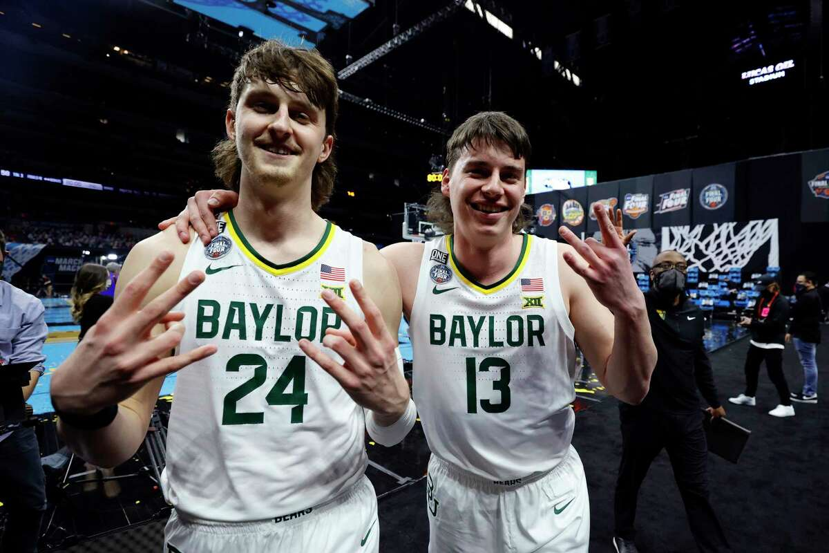 Matthew Mayer (24) and Jackson Moffatt (13) celebrate Baylor's win over Houston at the Final Four on Saturday. Moffatt, who played at Magnolia High School, inspired the mullet haircuts worn by some members of the team.