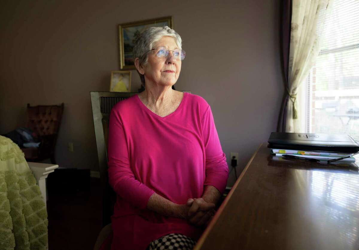 Charlsie Moore, 80, poses for a portrait in her home, Thursday, April 1, 2021, in Conroe. Moore recently received an award as the Texas Association of Mediators Volunteer of the Year and was named the nation's top mediator in 2019.