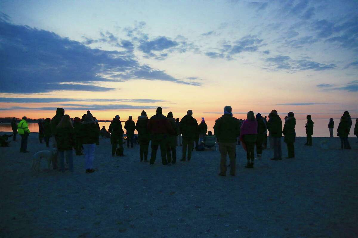 The morning light rises in the east during the Easter Sunday Sunrise Service at Compo Beach on April 4, 2021.