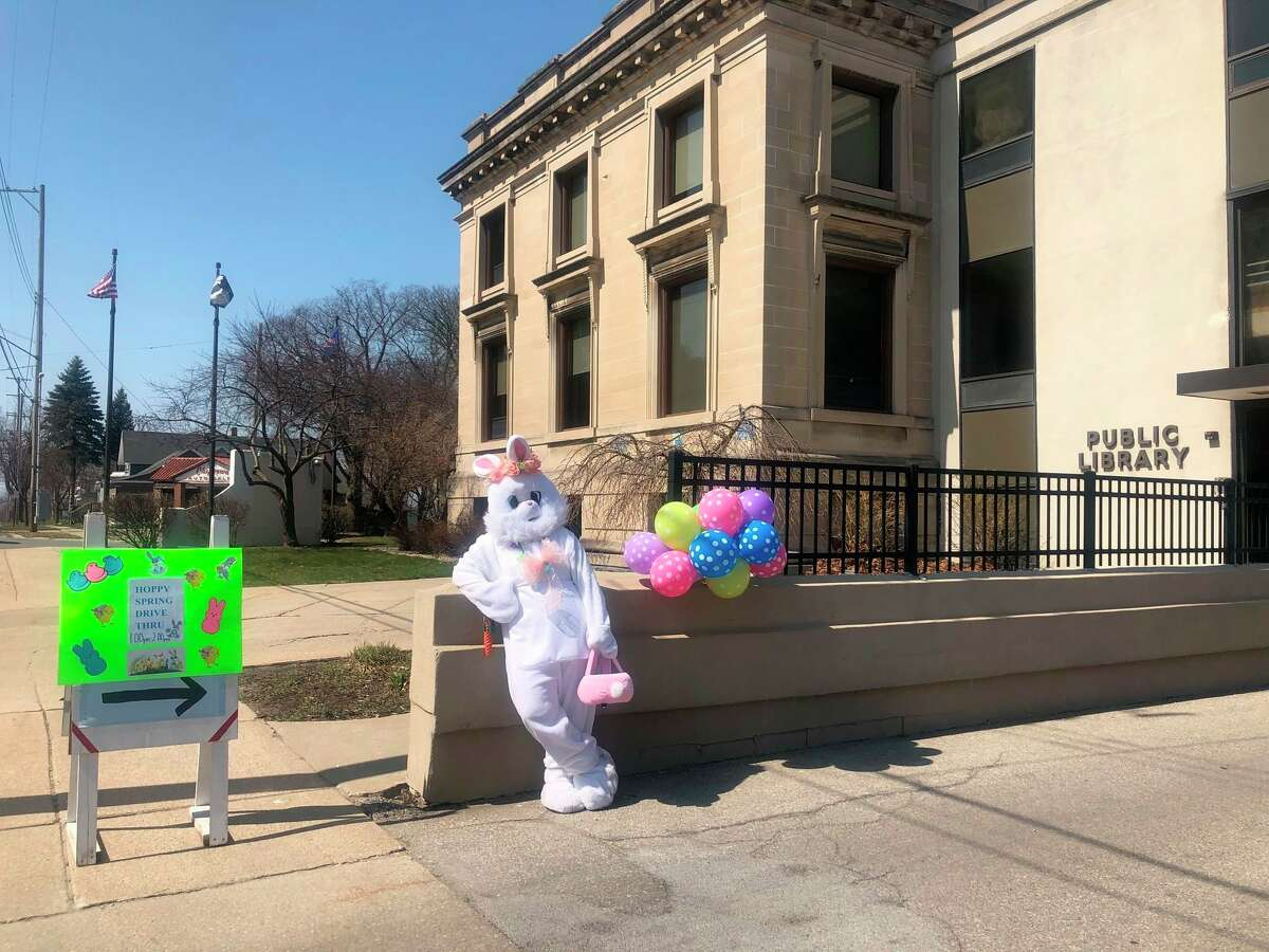 The Easter Bunny poses in front of the Manistee County Library. The library hosted a drive-thru Easter event Saturday. (Courtesy Photo)