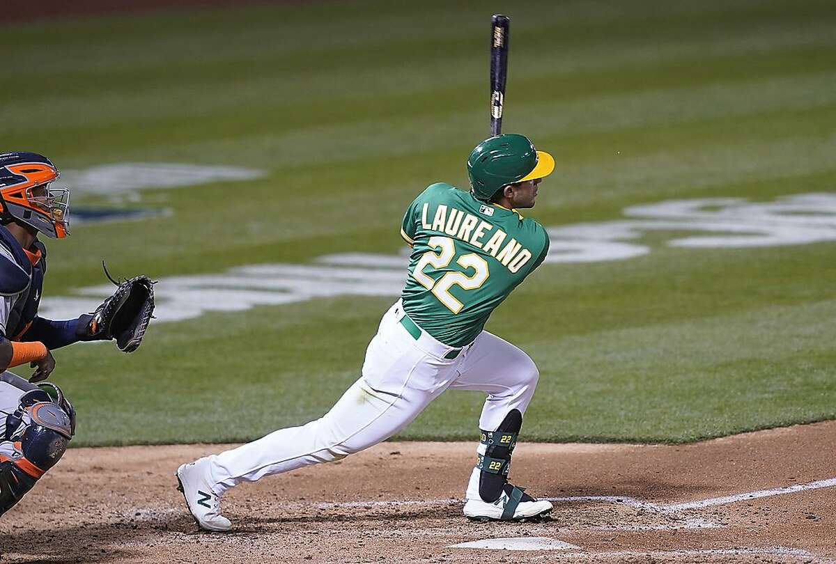 Ramon Laureano of the Oakland Athletics hits an RBI triple against the Houston Astros during the fourth inning at RingCentral Coliseum in Oakland, California, on Friday.The Astros prevailed to take the first two games of the series. (Thearon W. Henderson/Getty Images/TNS)