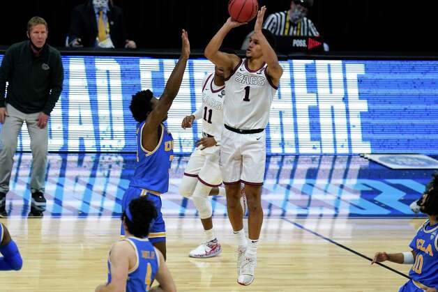 Gonzaga guard Jalen Suggs (1) shoots over UCLA guard David Singleton (34) to win the game during overtime in a men's Final Four NCAA college basketball tournament semifinal game, Saturday, April 3, 2021, at Lucas Oil Stadium in Indianapolis. Gonzaga won 93-90. (AP Photo/Michael Conroy) Photo: Michael Conroy, Associated Press / Copyright 2021 The Associated Press. All rights reserved.