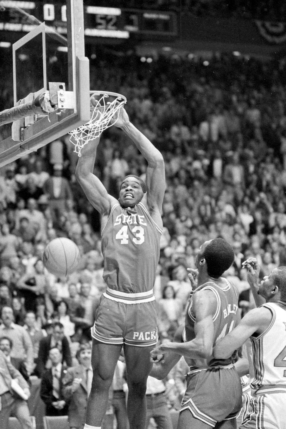FILE - In this April 4, 1983, file photo, North Carolina State's Lorenzo Charles (43) dunks the ball to give N.C. State a 54-52 win over Houston in the NCAA Final Four college basketball championship game in Albuquerque, N.M. The airball-turned-buzzer-beating dunk stunned top-ranked Houston. (AP Photo/File)