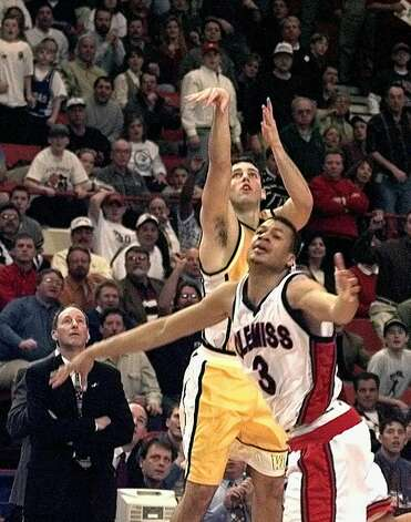 FILE - In this March 13, 1998, file photo, Valparaiso's Bryce Drew (20) follows through with his game-winning three-point shot at the buzzer over Mississippi's Jason Flanigan (3) in their first round game of the NCAA Midwest Regional in Oklahoma City. At left is Valparaiso coach Homer Drew watching his son's shot. (AP Photo/J.Pat Carter, File) Photo: J.PAT CARTER/AP / Copyright 2020 The Associated Press. All rights reserved.