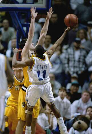 UCLA's Tyrus Edney (11) shoots the last second winning shot over Missouri's Derek Grim in the NCAA West Regionals in Boise, Idaho, Sunday, March 19, 1995. UCLA won 75-74. (AP Photo/Jack Smith) Photo: Jack Smith/AP