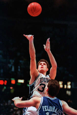 FILE - In this March 28, 1992, file photo, Duke's Christian Laettner takes the winning shot in overtime over Kentucky's Deron Feldhaus for a 104-103 victory in the East Regional final NCAA college basketball game in Philadelphia. (AP Photo/Charles Arbogast, File) Photo: Charles Arbogast/AP / Copyright 2020 The Associated Press. All rights reserved.
