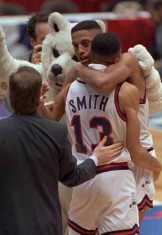 Connecticut's Tate George and Chris Smith, right celebrate their teams' final-second win over Clemson in the NCAA East Regional Semi-Finals at East Rutherford, N.J., on March 22, 1990. (AP Photo/Carol Francavilla) Photo: CAROL FRANCAVILLA/ASSOCIATED PRESS / AP1990
