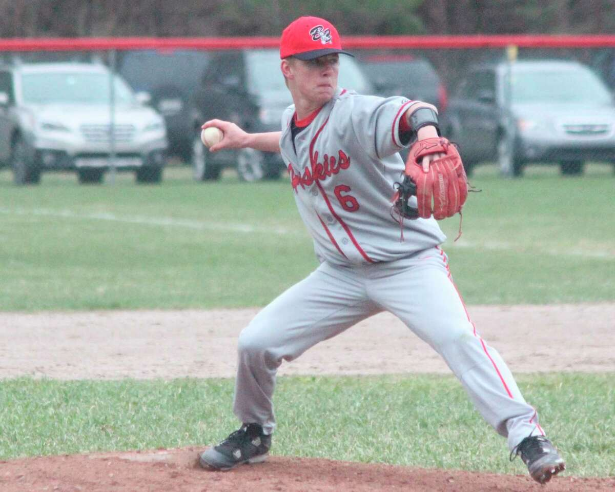 Dylan Bates winds up to deliver a pitch when he became one of the Huskies most reliable pitchers as a sophomore in 2019. (Record Patriot file photo)