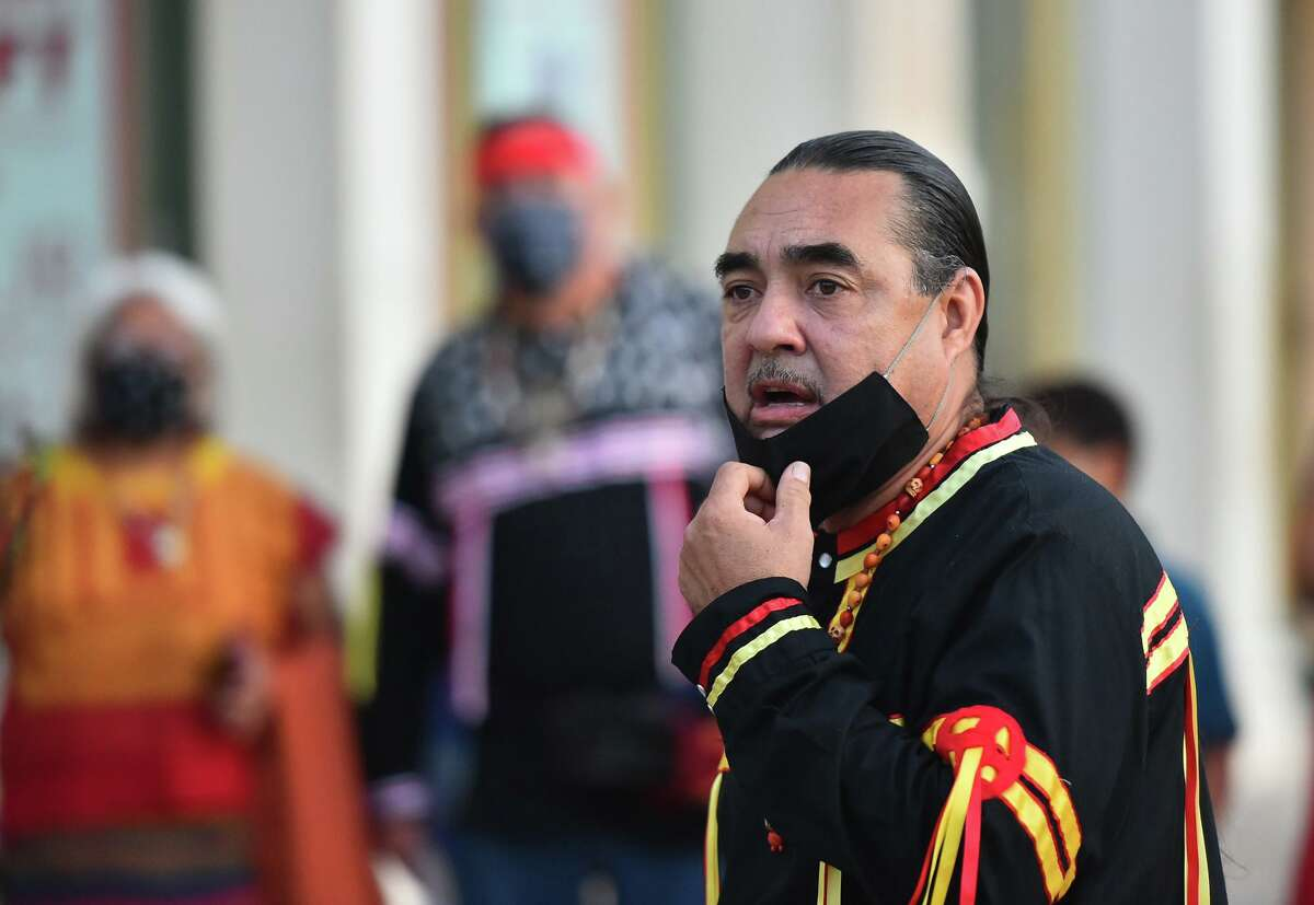 Ramon Vasquez of the Tap Pilam Coahuiltacan speaks during the group's 25th annual sunrise ceremony and run in front of the Alamo in September to honor ancestors buried inside the Shrine of Texas. Vasquez said the city's efforts to open a dialogue about human remains buried below Alamo Plaza is a step forward - but one that he wished had been taken the last time a plaza makeover had been discussed in the mid-1990s.