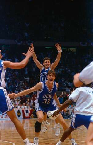 Christian Laettner of Duke Blue Devils yells out his jubilation after scoring the winning overtime basket against Connecticut Huskies. Teammate Bobby Urley is behind him. Photo: Bettmann/Bettmann Archive
