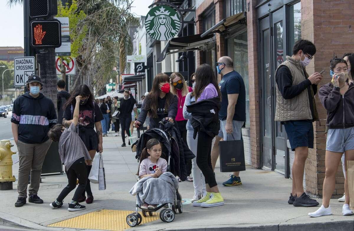Pedestrians pack sidewalks on Colorado Blvd. in Old Town Pasadena on Sunday, Mar. 21, 2021.