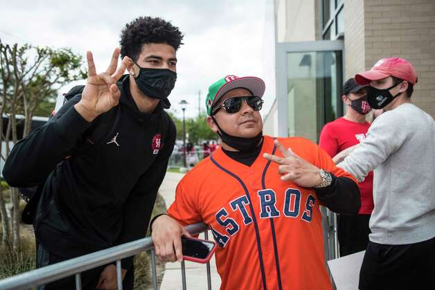 Houston guard Quentin Grimes, left, poses for a photo with UH fan Roc Borjas as the Cougars basketball team returned to campus from Indianapolis Sunday, April 4, 2021 in Houston, after the Cougars were eliminated from the Final Four Saturday night by Baylor. Photo: Brett Coomer, Staff Photographer / © 2021 Houston Chronicle