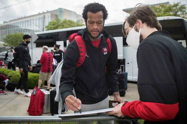 Houston forward Justin Gorham signs an autograph for UH student Jared Russell after the team returned to campus from Indianapolis Sunday, April 4, 2021 in Houston, after the Cougars were eliminated from the Final Four Saturday night by Baylor. Photo: Brett Coomer, Staff Photographer / © 2021 Houston Chronicle