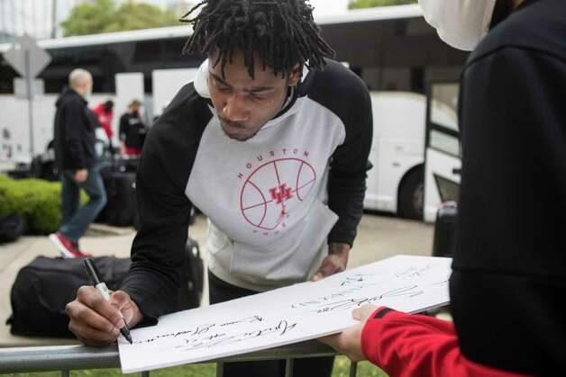 Houston forward Brison Gresham signs an autograph after arriving back to campus with his teammates from Indianapolis Sunday, April 4, 2021 in Houston, after the Cougars were eliminated from the Final Four Saturday night by Baylor. Photo: Brett Coomer, Staff Photographer / © 2021 Houston Chronicle