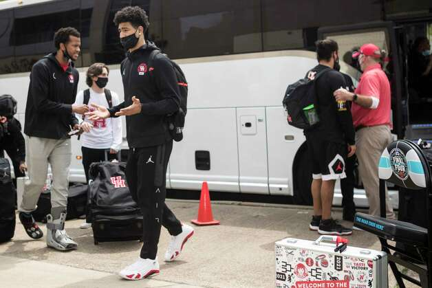 Houston forward Justin Gorham, left, and guard Quentin Grimes walk off the bus after the team arrived back to campus from Indianapolis Sunday, April 4, 2021 in Houston, after the Cougars were eliminated from the Final Four Saturday night by Baylor. Photo: Brett Coomer, Staff Photographer / © 2021 Houston Chronicle