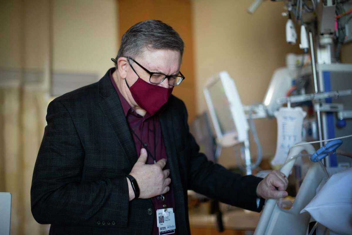 Brian Gowan, a chaplain at Houston Methodist, prays for Larry Coffey and his wife, Sonya.