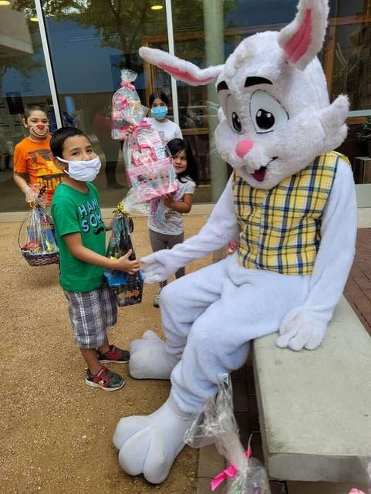 A local child interacts with the Easter Bunny during an event Thursday at Bethany House of Laredo.
