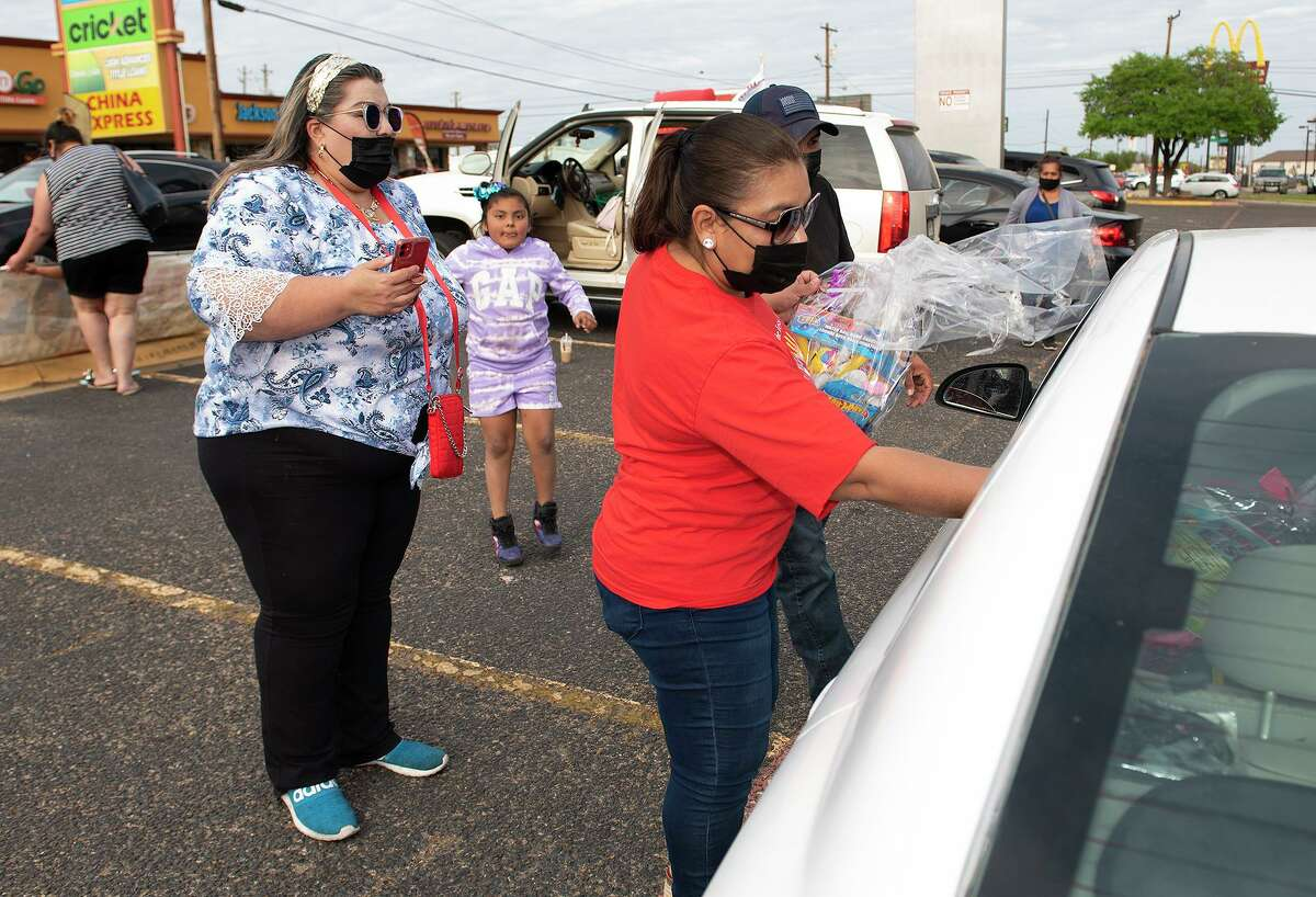 Mimi Helping the Less Fortunate members Mimi Espinoza, Katie Espinoza and Elvira Almanza give out Easter baskets to Laredoans in need on Friday, April 2, 2021 outside BBVA Bank's Guadalupe Street location.