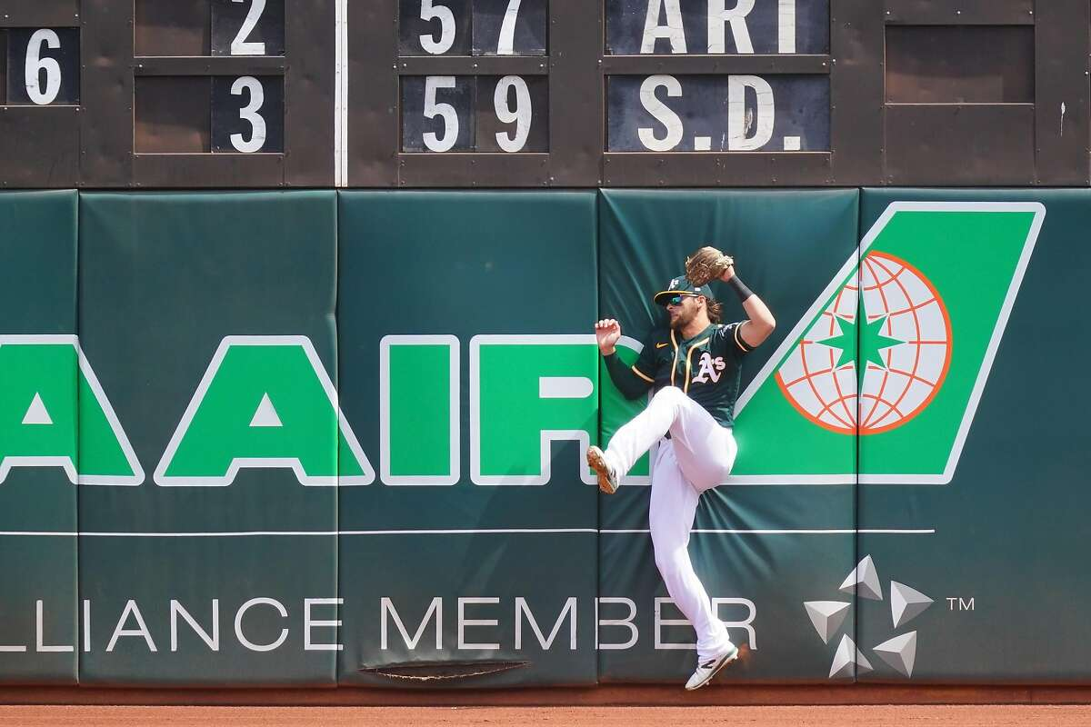 A's outfielder Chad Pinder made this leaping catch during the top of the first Sunday, but fell hard to the ground and left the game in the bottom of the inning.