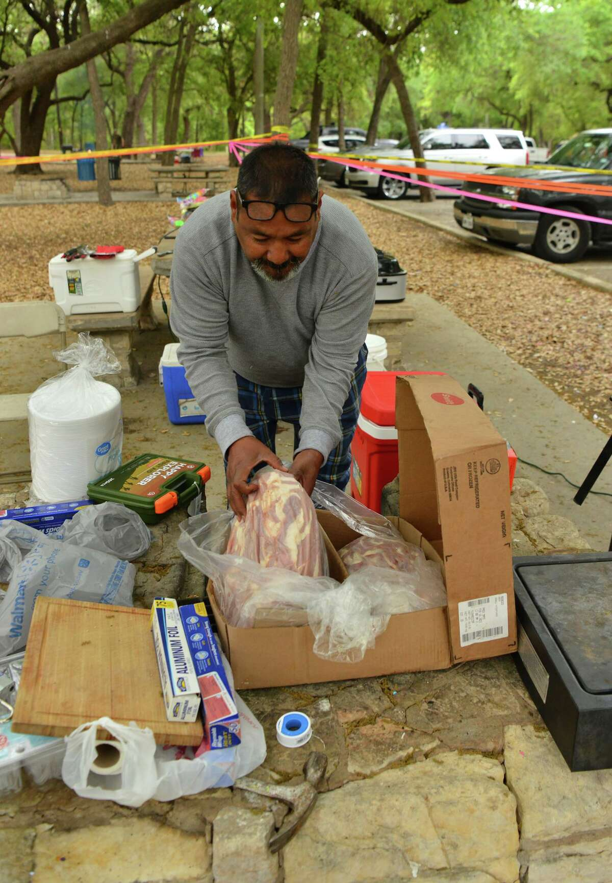 Samuel Rodriguez prepares his fripa's during an Easter Sunday barbeque in Brackenridge.