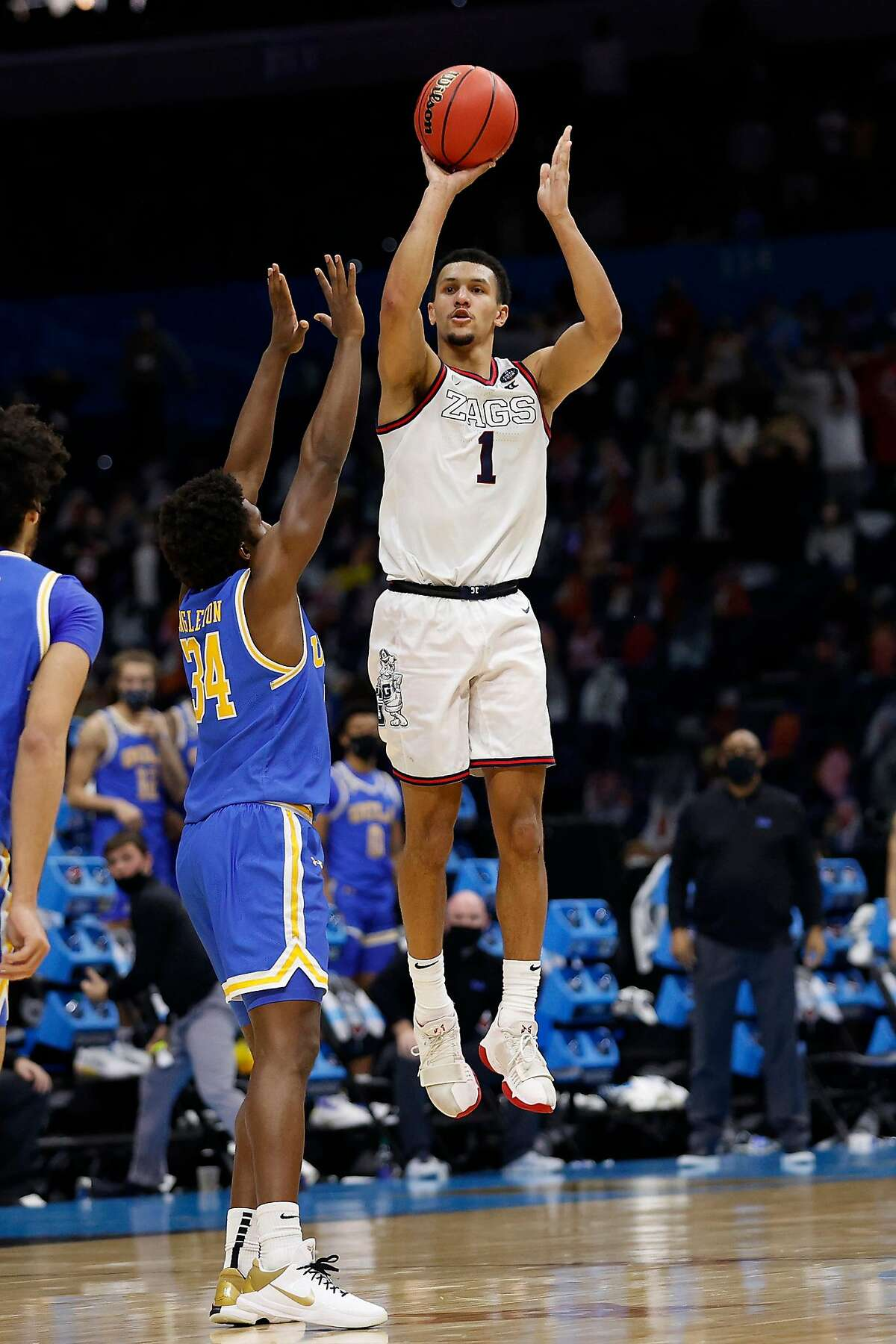 Gonzaga's Jalen Suggs (1) shoots the game-winning 3-point basket in overtime to defeat UCLA, 93-90, in the NCAA Tournament Final Four semifinals at Lucas Oil Stadium in Indianapolis on Saturday.