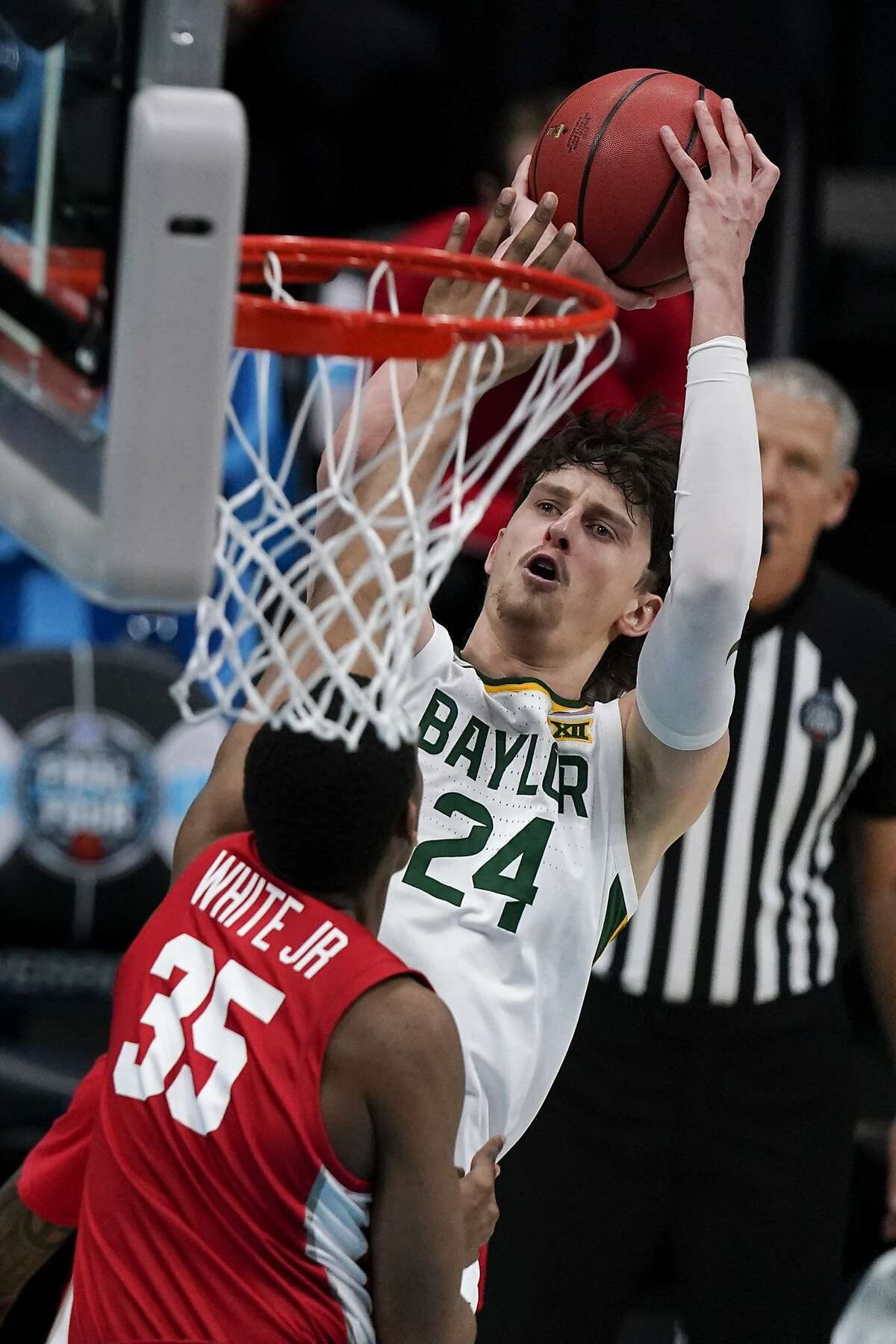 Baylor guard Matthew Mayer (24) shoots over Houston forward Fabian White Jr. (35) during the first half of a men's Final Four NCAA college basketball tournament semifinal game, Saturday, April 3, 2021, at Lucas Oil Stadium in Indianapolis.