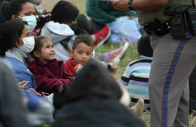 A Texas Department of Public Safety trooper questions migrant families after they were detained on Military Road west of La Joya, Texas, Friday, April 2, 2021. A group pf around 40 migrants, some unaccompanied minors, were detain in the area. Photo: Jerry Lara, San Antonio Express-News / **MANDATORY CREDIT FOR PHOTOG AND SAN ANTONIO EXPRESS-NEWS/NO SALES/MAGS OUT/TV   © 2019 San Antonio Express-News